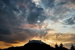 here comes the rain (.martinjakab) Tags: sunset sky cloud salzburg landscape austria sonnenuntergang wolken fujifilm fortress sunbeam festung ngi x100t