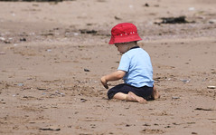 The Boy and the Sand (Danny VB) Tags: boy beach sand playing gaspesie quebec canada portrait colors kid garon dannyboy ef70200mmf4lusm canon7d canon eos 7d july summer people child children