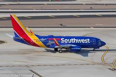 Southwest Airlines Boeing 737 N422WN -Shark Week--2535 (rob-the-org) Tags: iso100 noflash f90 cropped boeing decals 737 southwestairlines 120mm terminal4 phx discoverychannel phoenixaz sharkweek kphx 1160sec skyharborinternational n422wn parkinggaragep8