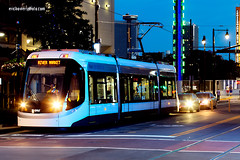 Kansas City Streetcar (ericbowers) Tags: night evening downtown cityscape publictransportation traffic zoom kansascity nighttime missouri transportation transit streetcar streetscape modeoftransport midwestusa builtstructure