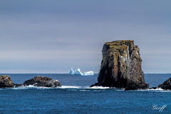 Icebergs and Rocks (gwhiteway) Tags: ocean park travel blue light sea white canada cold tourism ice nature water clouds canon newfoundland season lens coast alley rocks waves air north scenic dungeon science tourist calm atlantic glacier arctic trail freeze 7d change environment iceberg nl polar discovery 1740mm climate 100400mm warming nfld global provincial bonavista 50d