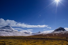 Sun on the mountain (Gremy-Photographie) Tags: voyage camera travel blue light sky sun sunlight white mountain nature colors beautiful beauty yellow clouds jaune 35mm canon landscape photography soleil photo iceland amazing colorful day alone afternoon photographer photographie view hiking walk roadtrip hike jour bleu ciel walker lumiere pro pm nuage paysage 16mm backpacker blanc vacance islande journe seul icelandic photooftheday picoftheday naturelovers worldtour 1635mm tourdumonde 100d eos100d