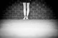 Flash (spannerino) Tags: light newzealand blackandwhite blur texture film monochrome wall contrast analog 35mm legs pentax outdoor bricks grain wideangle auckland 35mmfilm scanned pointandshoot analogue vignette expiredfilm handprocessed filmlives ilfordlc29 pentaxespiomini canon9000f