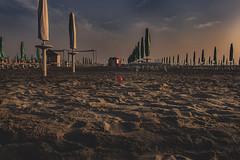 The small red ball (Enricodot ) Tags: sunset red sea sun beach umbrella sunrise ball seaside sand ombrelloni adriaticsea ilobsterit enricodot