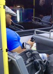 IMG_4611 (danimaniacs) Tags: newyork man hot sexy guy pecs hat cellphone hunk cap