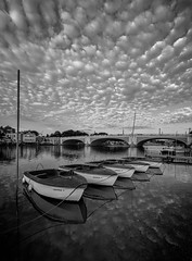 Thames at rest (A time for reflection) II - Explored (faranorclarke) Tags: uk summer sky bw cloud reflection water thames clouds river boats boat blackwhite nikon wide sigma wideangle relection summertime 1020mm riverbank 1020 riverthames hamptoncourt lightroom d90 hamptoncourtbridge