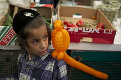 (Caitlin H. Faw) Tags: light shadow portrait orange color bird face vegetables fruit canon eos israel eyes market jerusalem balloon may strawberries 5d marketplace hebrew plaid kippah yerushalayim kippa markiii 2013 mahaneyehudamarket caitlinfaw caitlinfawphotography