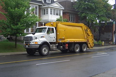 City of Ottawa A861010 12-3202 Sterling garbage straight truck with a Universal Handling Equipment UHE rear load body Ottawa 09112007 ©Ian A. McCord (ocrr4204) Tags: ontario canada yellow trash jaune truck garbage ottawa camion rubbish universal sterling waste mccord refuse glebe trucking sanitation strobelight cityofottawa straighttruck rearload ianmccord ianamccord {vision}:{outdoor}=0871 {vision}:{car}=083