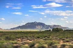 Arizona Mountain (KamrenB Photography) Tags: shadow arizona sky usa mountain blur clouds canon photography moving haze driving desert zoom random rocky huge kamgtr kamrenb