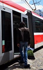 Man Getting in the Tram (Kojotisko) Tags: street people streets person streetphotography brno cc creativecommons czechrepublic streetphoto persons fujifilmfinepix fujifilmfinepixsl1000 fujifilmfinepixsl1000kojotisko
