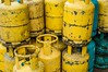 Used gas containers... (Syahrel Azha Hashim) Tags: street travel light detail colors yellow 35mm prime nikon colorful dof market streetphotography naturallight gas used malaysia handheld shallow simple household stacked johor containers recyclable pressurized benut cookinggas d300s syahrel