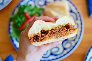 Chicken Torta | ($10.50) a chili, garlic, and spiced chicken adobo with refried beans, rice, avocado, and a touch of butter Photo: Fonda Lola