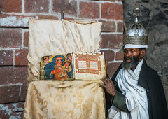 Ethiopian orthodox priest with an old bible in nakuto lab rock church, Amhara region, Lalibela, Ethiopia (Eric Lafforgue) Tags: africa people man color church horizontal silver religious reading book clothing day adult african faith religion monk christian unescoworldheritagesite holy indoors monastery devotion bible civilization crown priest christianity shawl spirituality ethiopia oneperson developingcountry gez lalibela engravings hornofafrica geez ethiopian eastafrica orthodoxchurch abyssinia manuscripts traditionalclothing realpeople cavechurch waistup adultonly onematuremanonly traveldestination 1people africanculture amhararegion ethio163798