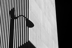 Silhouetted lamp post in front of building on a sunny afternoon downtown Seattle (Jim Corwin's PhotoStream) Tags: seattle city blackandwhite bw building lines horizontal architecture contrast outdoors photography design streetlight downtown cityscape shapes nobody line lamppost silhouetted lightanddark urbanscene buildingexterior