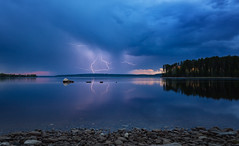 Thunder vs sunset (L.Matero) Tags: blue trees sunset summer sky orange water night canon finland island rocks long exposure awesome lightning thunder f4 6d 1635 kainuu suomussalmi