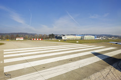 Taxiing past hangars (A. Wee) Tags: tarmac switzerland airport zurich hangar  zrh