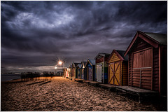 Iconic beach boxes, Brighton Beach, Melbourne, Australia (Chas56) Tags: ngc brighton brightonbeach melbourne sand beachboxes canon canon5dmkiii buildings architecture 1635mm night dark nightphotography silhouettes tourists people dramatic storm clouds beach sea seaside bay portphillipbay colour color
