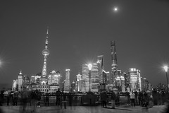 Shanghai at night (Kelly Eaton) Tags: china city travel people blackandwhite moon tourism architecture night scenery mood shanghai financialdistrict busy bund the bustling