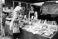 Shopping for hazelnuts at the Ballard Farmer's Market. Seattle, WA. July 2016. (poopoorama) Tags: ballard dannyngan dannynganphotography fujifilm seattle xseries x100t bw blackandwhite farmersmarket market street streetphotography washington unitedstates
