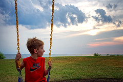 Over My Shoulder (HJharland5) Tags: sunset ohio sky sun lake water clouds nikon outdoor cleveland swings swingset j5