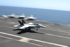 A Super Hornet lands on the flight deck. (Official U.S. Navy Imagery) Tags: heritage america liberty freedom commerce unitedstates military navy sailors fast worldwide tradition usnavy protect deployed flexible onwatch beready defendfreedom northarabiansea warfighters nmcs chinfo sealanes warfighting preservepeace deteraggression operateforward warfightingfirst navymediacontentservice