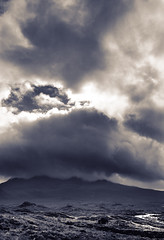 Skye - Cuillin Hills in Clouds (JB Morlot) Tags: uk travel sky blackandwhite mountain abstract skye film tourism against sepia clouds danger mediumformat landscape hope design scotland countryside isleofskye dynamic faith fineart country religion hunting decoration atmosphere desperate fate believe zen destiny serenity future collapse moors 6x9 nordic meditation therapy wilderness tempest moor westernisles climatechange crisis largeformat cuillinhills mystic globalwarming hebrides anxious otherworld psychology facing hopeless agressive cuillin adversity scottishlandscape naturalelements fujigsw690iii