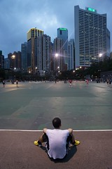 Hong Kong - Victoria Park (jerome taylor) Tags: china city travel urban sport modern youth hongkong football asia sitting skyscrapers dusk chinese young photojournalism travelphotography