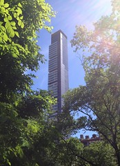 Madison Square Jungle (janniswerner) Tags: cameraphone park city nyc newyorkcity trees urban ny newyork building tree green tower leaves architecture skyscraper square leaf high branch cityscape slim manhattan branches brush spire oasis madison jungle tall residential bushes thicket iphone madisonsquare madisonsq apartmenttower iphone4s
