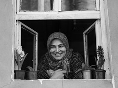 a little hello out of the window // tirilye, turkey (pamela ross) Tags: street bw woman window smile face pen turkey happy expression olympus istanbul laugh lurking tirilye pamelaross epl5