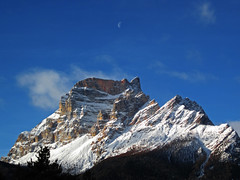 Waning moon (Robyn Hooz) Tags: blue sky italy moon mountain canon landscape sad space peak powershot gone far waning d10 vaste pelmo