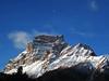 Waning moon (Robyn Hooz) Tags: blue sky italy moon mountain canon landscape sad space peak powershot gone far waning d10 vaste pelmo