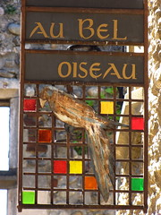 Au Bel Oiseau (K.G.Hawes) Tags: old city red france color colour building bird glass stain colors sign buildings square french town colours village squares au creative commons medieval stained cc creativecommons bel oiseau perouges prouges