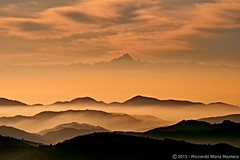 Layers of Pink (Riccardo Maria Mantero) Tags: pink italy mist mountain mountains alps fog clouds landscape hills layers riccardo cervino hilltops mantero appenine anawesomeshot afsvrzoomnikkor70300mmf4556gifed nikonflickraward