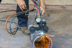 manual pipe cutting (sydeen) Tags: man industry metal work fire dangerous energy uniform technology action steel tube pipe safety sparkle equipment flame torch metalwork worker constructionsite spark protection cutter acetylene workwear gascutting flamecutting oxyfuelcutting