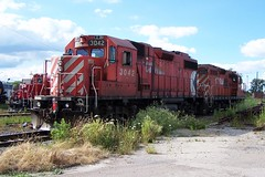 CP 3042 CP 8219 Woodstock, Ontario Canada 07202007 ©Ian A. McCord (ocrr4204) Tags: railroad red ontario canada train rouge diesel kodak rail railway loco pointandshoot locomotive canadianpacific mccord woodstock gp generalmotors geep gp9 z740 diesellocomotive dieselelectric ianmccord ianamccord