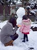 Finishing Touches (Jake in Japan) Tags: winter portrait snow cold cute girl japan snowman sony daughter mother wife hood 雪 冬 雪だるま 寒 カワイイ e1855mmf3556oss sel1855 nex7 ©jakejung gettyimagesjapan14q1