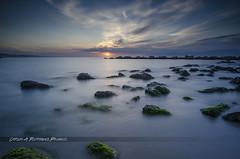 Sunrise / Amanecer (_carlosRP) Tags: barcelona longexposure sea seascape clouds landscape mar rocks mediterranean mediterraneo bcn catalonia barceloneta nubes catalunya rocas