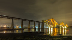 Forth Bridges Edit (Christopher Combe Photography) Tags: bridge heritage water night reflections river lights coast scotland rocks edinburgh transport bridges firthofforth forthbridges