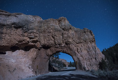Starry night in Utah (Cat Girl 007) Tags: road park longexposure nightphotography sky nature stone glitter stars landscape outside outdoors utah highway sandstone rocks arch space scenic rocky tunnel twinkle astro galaxy nightsky passage cosmic starry countryroad rockformations redcanyon archbridge starfield pavedroad scenicbyway12 horizontalimage