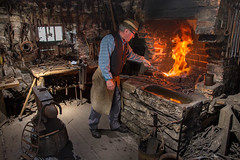 The Blacksmith's Forge (Alan10eden) Tags: chimney portrait man hot history metal hammer work canon iron smoke flames environmental sigma tools historic indoors heat workplace horseshoe blacksmith forge coal furnace trade bellows redhot olddays oldfashioned anvil ulster omagh blackiron ulsteramericanfolkpark 70d 1770mm alanhopps coutytyrone