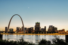 St Louis Skyline From the Wrong Side of the Tracks (AJ Brustein) Tags: city blue sunset moon reflection st canon river mississippi louis illinois downtown cityscape dusk mark iii stlouis casino crescent queen east missouri hour gateway 5d riverfront bluehour hdr 5dm3