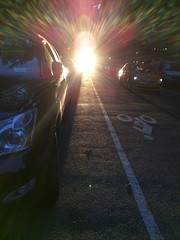 Sunset in Manhattan (Henry Hemming) Tags: street sunset sun car island manhattan flare length across sunspot