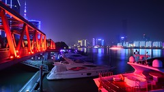 Shanghai - Marina at the Shipyard Bridge (cnmark) Tags: china bridge red marina project noche boat shanghai riverside nacht yacht steel promenade noite   shipyard pudong avenue nuit  luxury development notte nachtaufnahme lujiazui   allrightsreserved