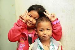 sending you peace (the foreign photographer - ) Tags: boy two girl sign portraits canon children thailand kiss peace bangkok neighbors 400s khlong bangkhen thanon