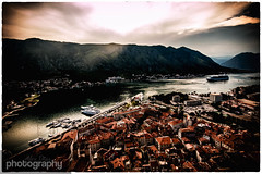 Kotor Bay Evening (Alex Chilli) Tags: city trip travel sunset summer vacation sun mountain holiday water canon lens eos evening bay town high view sigma vista below beneath montenegro kotor 70d