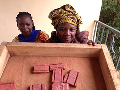 aissata and soap girl (The Advocacy Project) Tags: africa training outdoors justice soap women peace quilting local mali income womensrights fellowship survivors trainingcenter soapmaking communitybuilding peacefellowship advocacyproject confidencebuilding sinisanuman
