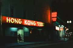Neon Noir I (Daniel Scarnecchia) Tags: 50mm nikon danielscarnecchia people massachusetts 2016 film harvardsquare f3 800t cinestill streetphotography cambridgema believeinfilm unitedstates harvard f14 filmisnotdead cambridge cinestill800t ma usa harvarduniversity