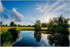 Silence before the storm (nandOOnline) Tags: zonsondergang fuji nederland wolken fujifilm zon vijver zonlicht reflectie mierlo regenwolken regenbui nbrabant xpro2