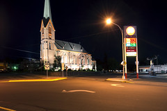 Old St. Peter's Landmark (Curtis Gregory Perry) Tags: street old longexposure food church station sign st architecture night nikon streetlight cathedral top gothic landmark gas spire arrow lotto peters atm thedalles tier prices mart 76 revival d800e