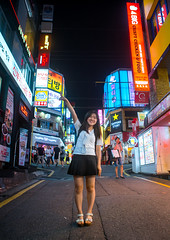 North korean teen defector in the streets of gangnam, National capital area, Seoul, South korea (Eric Lafforgue) Tags: city people urban woman streets vertical night buildings advertising asian outdoors lights town colorful asia neon place outdoor refugee capital sightseeing korea location seoul teenager colourful fullframe southkorea youngadult groupofpeople interest metropolitan oneperson defector lookingatcamera northkorean armup 9people nationalcapitalarea colourpicture koreanscript sk162383